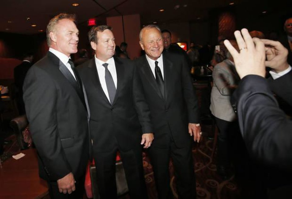 Photo -  Brian Bosworth poses with Bob Stoops (center) and Barry Switzer before the 2016 Oklahoma Sports Hall of Fame banquet, when Bosworth was inducted. (Photo by Nate Billings)