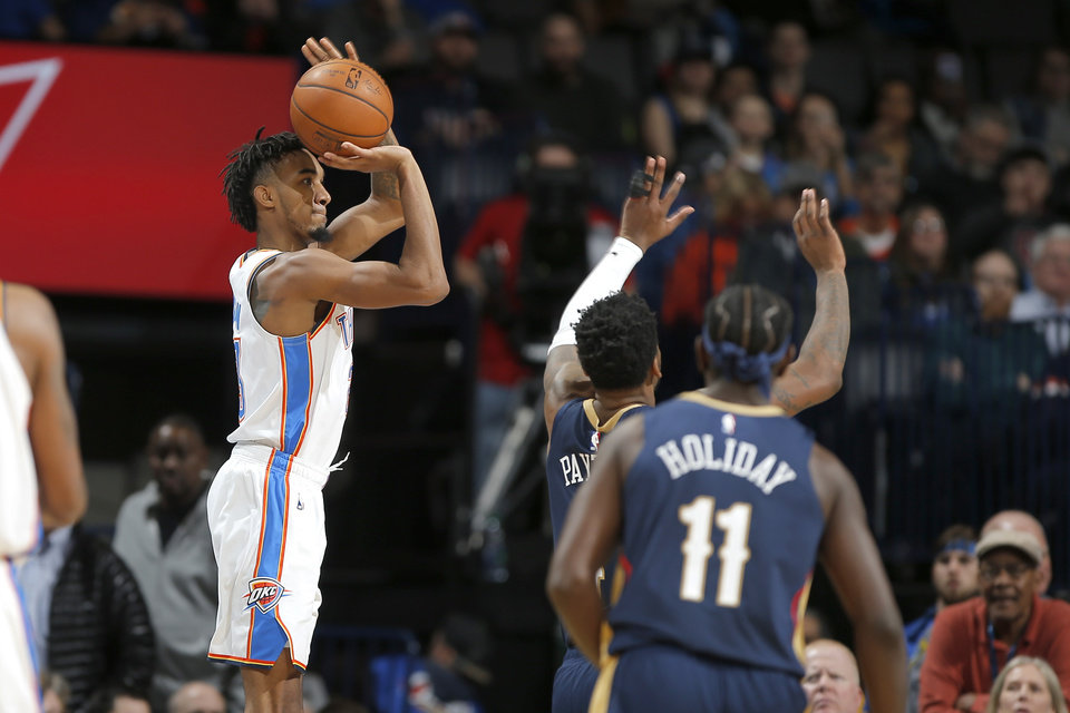 Photo - Oklahoma City's Terrance Ferguson (23) shoots a 3-pointer during an NBA basketball game between the Oklahoma City Thunder and the New Orleans Pelicans at Chesapeake Energy Arena in Oklahoma City, Thursday, Jan. 24, 2019. Photo by Bryan Terry, The Oklahoman