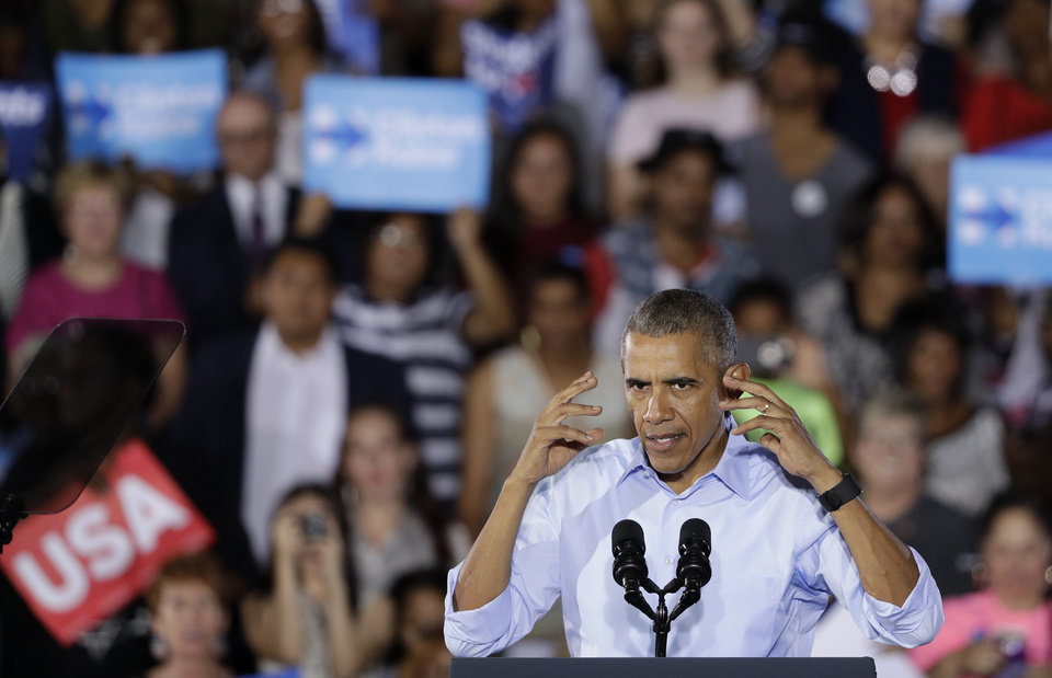 Photo - President Barack Obama speaks at a rally Sunday, Oct. 23, 2016, in North Las Vegas, Nev. Obama was in Nevada to boost Hillary Clinton's presidential campaign and help Democrats in their bid to retake control of the Senate.(AP Photo/John Locher)