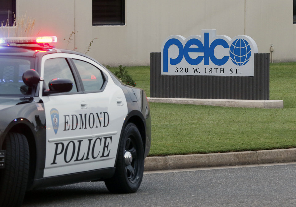 Photo - An early morning shooting left one person injured at Pelco Products at 320 W 18th St. in Edmond, Okla. Tuesday, Aug. 8, 2017.  Photo by Paul Hellstern, The Oklahoman