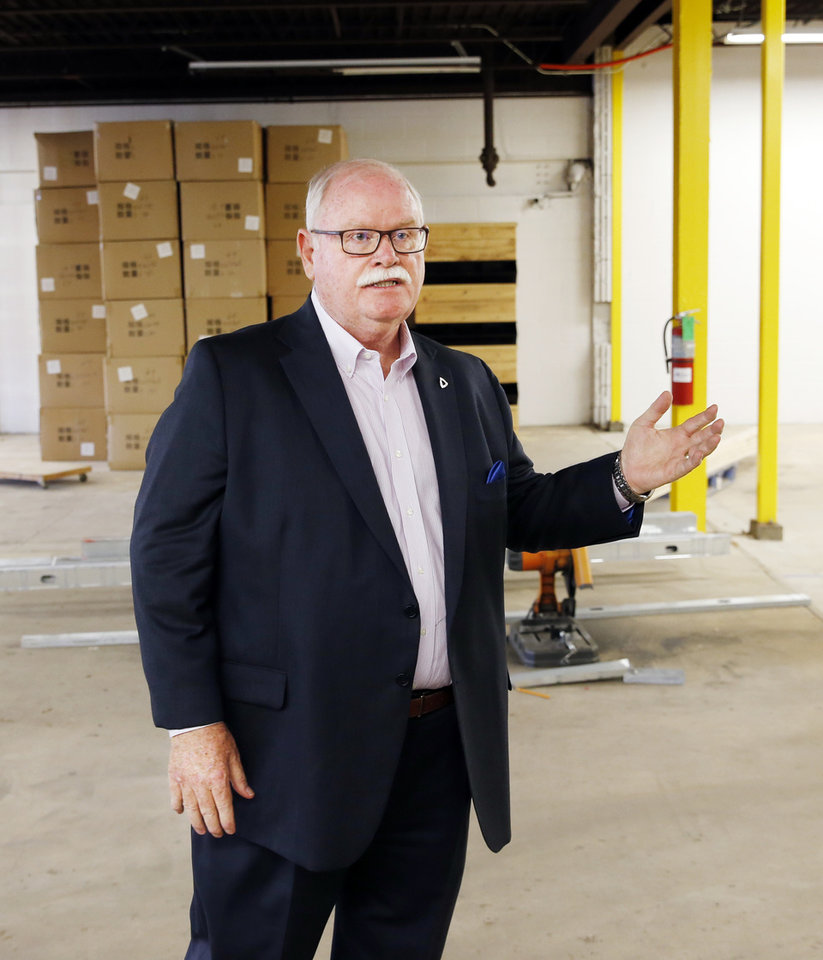 Photo -  Randy Lacey, industrial broker with CBRE, talks about Project 3810 in the warehouse section at 3810 N Tulsa Ave. [PHOTO BY NATE BILLINGS, THE OKLAHOMAN]