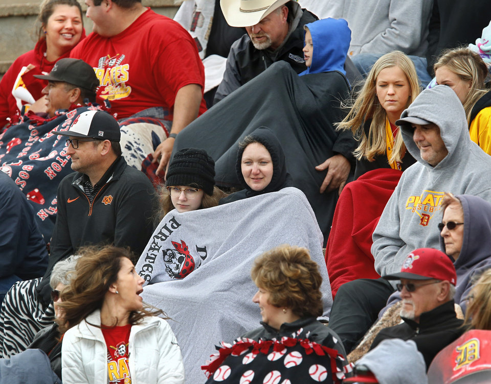 Photo - Dale fans are bundled against unseasonably cool temperatures and northerly winds as they watch their players defeat Christian Heritage Academy, 11-0,  during the Class 2A state quarterfinal game at Shawnee High School Thursday, May 9, 2019.  [Jim Beckel/The Oklahoman]