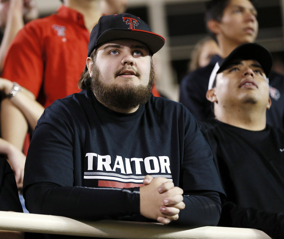 "Photo - Texas Tech fan Trey Parker wears a shirt that says ""traitor"" referencing OU quarterback Baker Mayfield during a college football game between the University of Oklahoma Sooners and Texas Tech Red Raiders at Jones AT&T Stadium in Lubbock, Texas, Saturday, Oct. 22, 2016. Photo by Nate Billings, The Oklahoman"