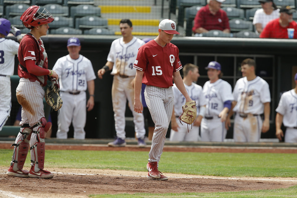 Photo -  Oklahoma's Wyatt Olds (15) walks back to the mound beside Brady Lindsly after a TCU run in the fourth inning of a Big 12 baseball tournament game between the University of Oklahoma (OU) and TCU at Chickasaw Bricktown Ballpark in Oklahoma City, Okla., Thursday, May 23, 2019.  [Bryan Terry/The Oklahoman]
