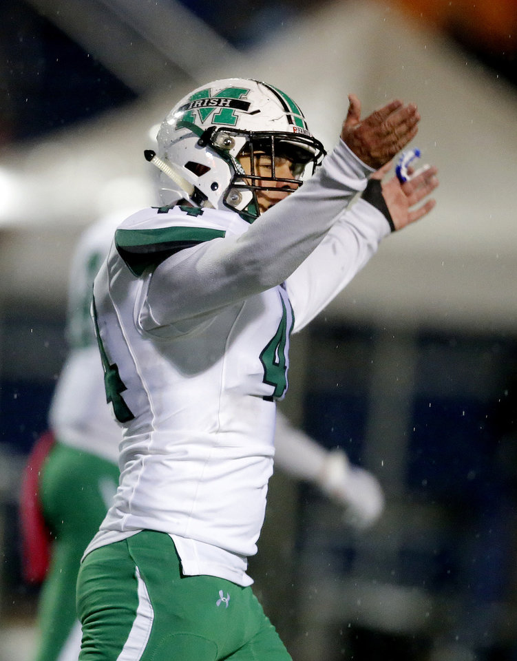 Photo - Bishop McGuinness's Andrew Chambers celebrates during the high school football game between Piedmont and Bishop McGuinness at Piedmont High School in Piedmont, Okla.,  Friday, Oct. 25, 2019. [Sarah Phipps/The Oklahoman]