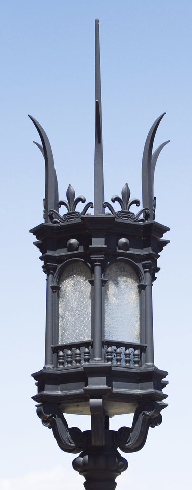 Photo - Left: Iron lamps and other decorative touches are important parts of the architectural significance of the former Central High School building. Right: Sculptured stone panels and other ornamentation give the century-old building an ageless look.