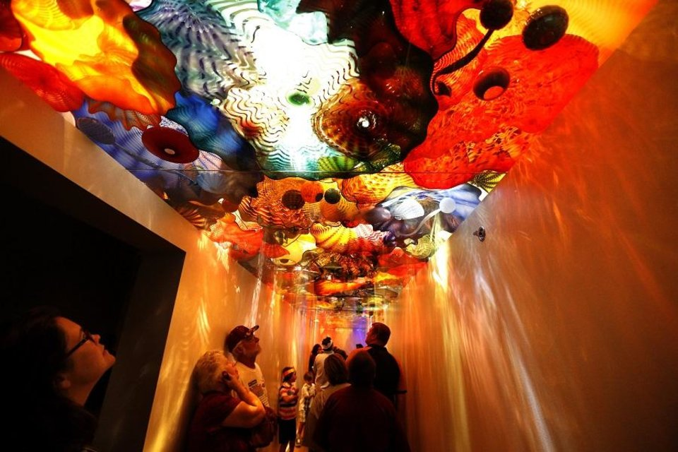 Photo - People walk through the Chihuly exhibit during Free Family Day at the Oklahoma City Museum of Art, Sunday, Sept. 7, 2014.  [Sarah Phipps/The Oklahoman Archives]