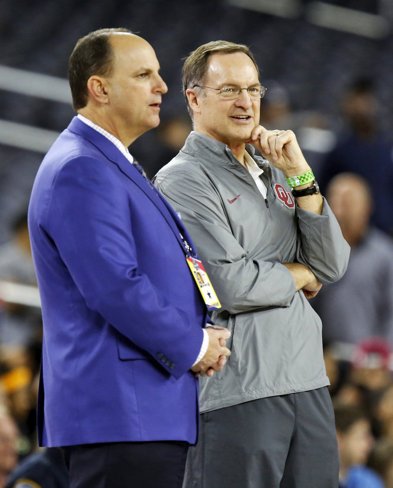 Photo - Oklahoma coach Lon Kruger, right, talks to OU director of athletics Joe Castiglione during practice on Final Four Friday before the national semifinal between the Oklahoma Sooners and the Villanova Wildcats in the NCAA Men's Basketball Championship at NRG Stadium in Houston, Friday, April 1, 2016. OU will play Villanova in the Final Four on Saturday. Photo by Nate Billings, The Oklahoman