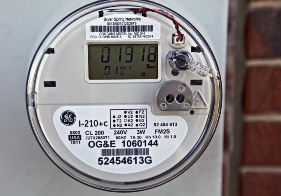 Photo -  A smart meter is seen on a Piedmont home. The Oklahoma Corporation Commission on Thursday adopted a request filed by its Public Utility Division that provides utilities with assurances they can recover bad debt generated by pandemic-impacted customers who can't pay their bills. [THE OKLAHOMAN ARCHIVES]