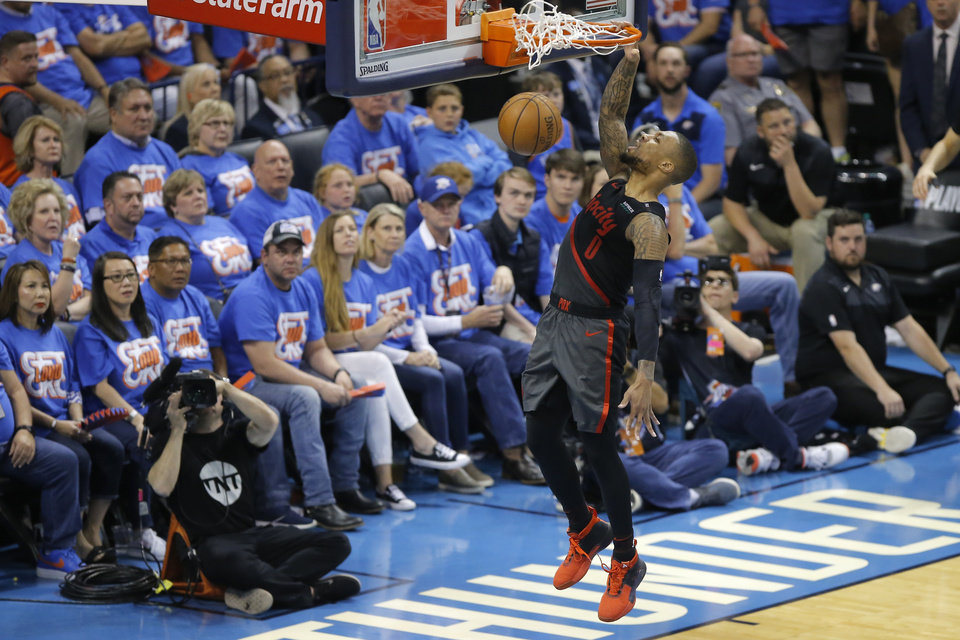 Photo - Damian Lillard (0) dunks during Game 4 in the first round of the NBA playoffs between the Portland Trail Blazers and the Oklahoma City Thunder at Chesapeake Energy Arena in Oklahoma City, Sunday, April 21, 2019. Portland won 11-98.  Photo by Bryan Terry, The Oklahoman