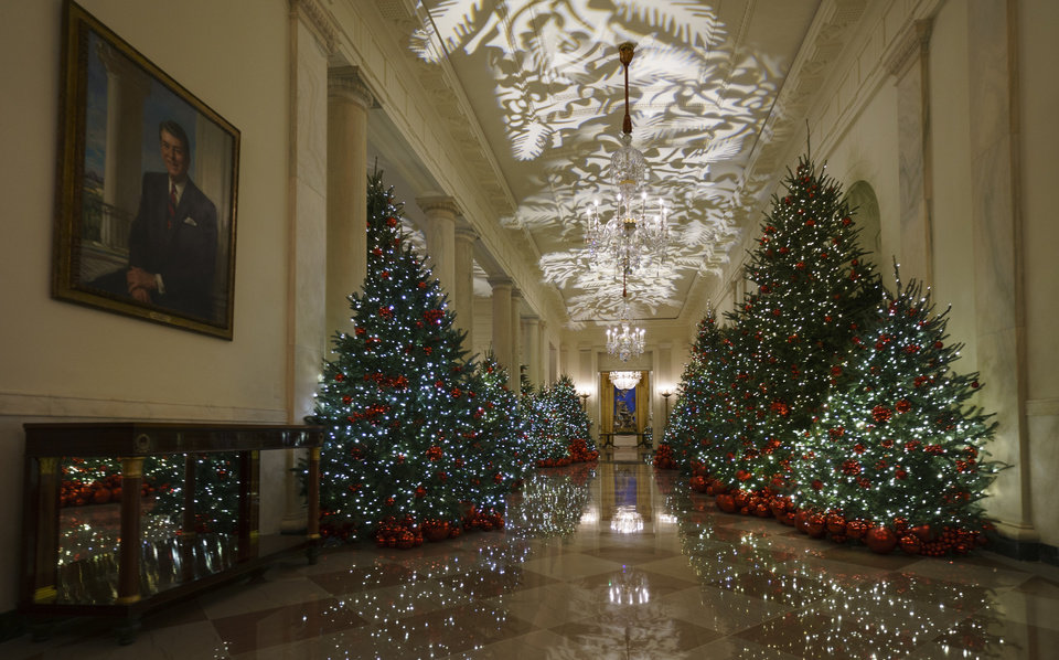 "The Cross Hall is seen during the 2018 Christmas Press Preview at the White House in Washington, Monday, Nov. 26, 2018. Christmas has arrived at the White House. First lady Melania Trump unveiled the 2018 White House holiday decor on Monday. She designed the decor, which features a theme of ""American Treasures."" (AP Photo/Carolyn Kaster)"