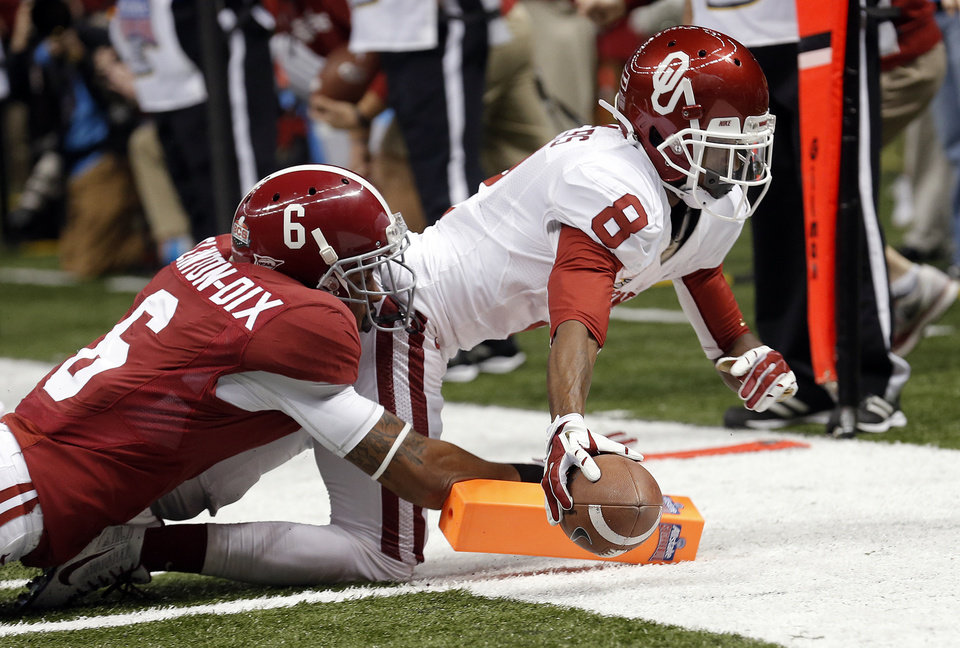 Photo -  Oklahoma's Jalen Saunders (8) dives for a touchdown as Alabama's Ha Ha Clinton-Dix (6) tackles him during the NCAA football BCS Sugar Bowl game between the University of Oklahoma Sooners (OU) and the University of Alabama Crimson Tide (UA) at the Superdome in New Orleans, La., Thursday, Jan. 2, 2014.  .Photo by Sarah Phipps, The Oklahoman