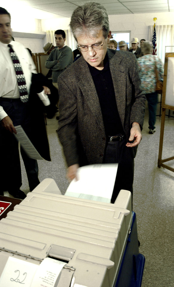 Photo - Muskogee, Oklahoma, Tuesday, 11/2/04.      ELECTION, VOTER, VOTERS, VOTE: U.S. Senate candidate Tom Coburn inserts his ballot into the voting machine  at Memorial Christian Church in Muskogee. Staff photo by David McDaniel.