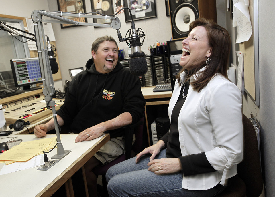 Photo - Gary Scott Thomas and Julie Stevens work the mics during their daily morning show at radio station KRTY in San Jose, California, on December 9, 2010. The best of friends, they have done the Gary & Julie show for more than 10 years. (Gary Reyes/San Jose Mercury News/MCT)