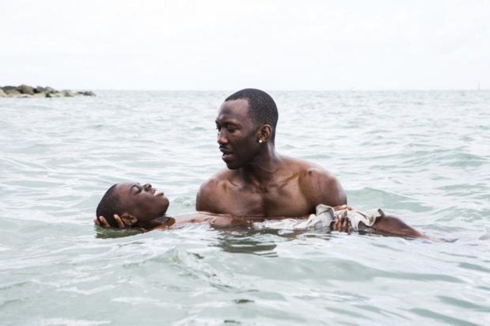 Photo - Alex Hibbert, left, and Mahershala Ali appear in a scene from the film