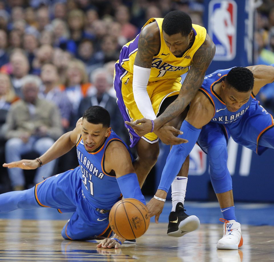 Photo - Oklahoma City's Andre Roberson (21) and Russell Westbrook (0) go for the ball beside Los Angeles' Kentavious Caldwell-Pope (1) during an NBA basketball game between the Oklahoma City Thunder and the Los Angeles Lakers at Chesapeake Energy Arena in Oklahoma City, Wednesday, Jan. 17, 2018. Photo by Bryan Terry, The Oklahoman