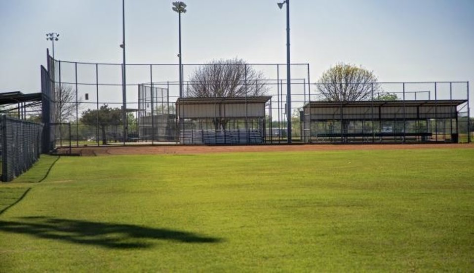 Photo -  The closed ball fields at Wild Horse Park in Mustang, Okla. on Wednesday, April 15, 2020. The Coronavirus has shut down youth sports in Oklahoma and across the nation.  [Chris Landsberger/The Oklahoman]