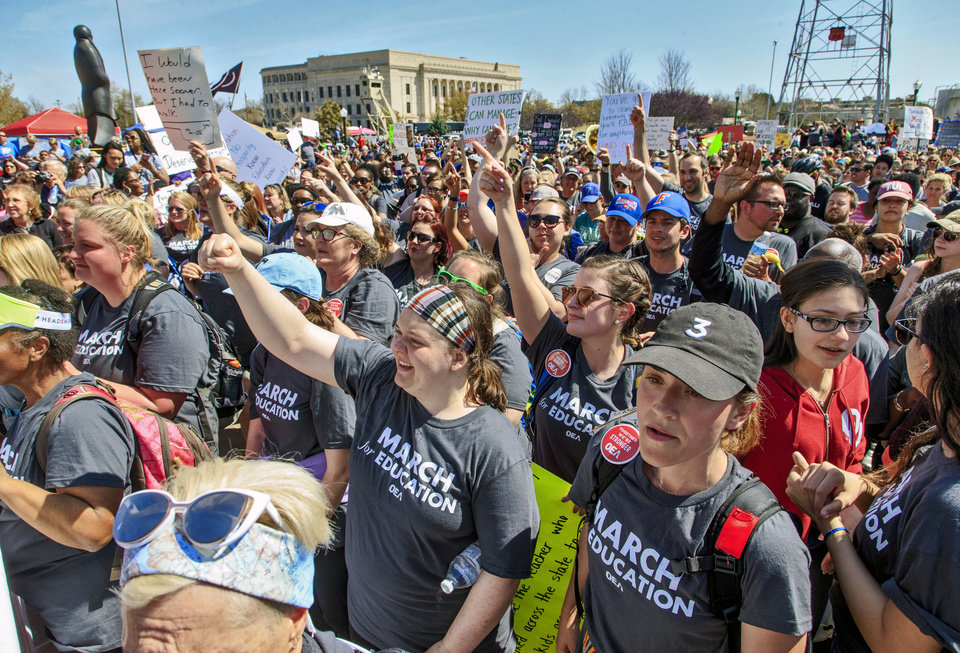 Photo - Teachers gather on the south side of the Capitol as they finish their 110 mile walk from Tulsa during the ninth day of a walkout by Oklahoma teachers at the state Capitol in Oklahoma City, Okla. on Tuesday, April 10, 2018.   Photo by Chris Landsberger, The Oklahoman