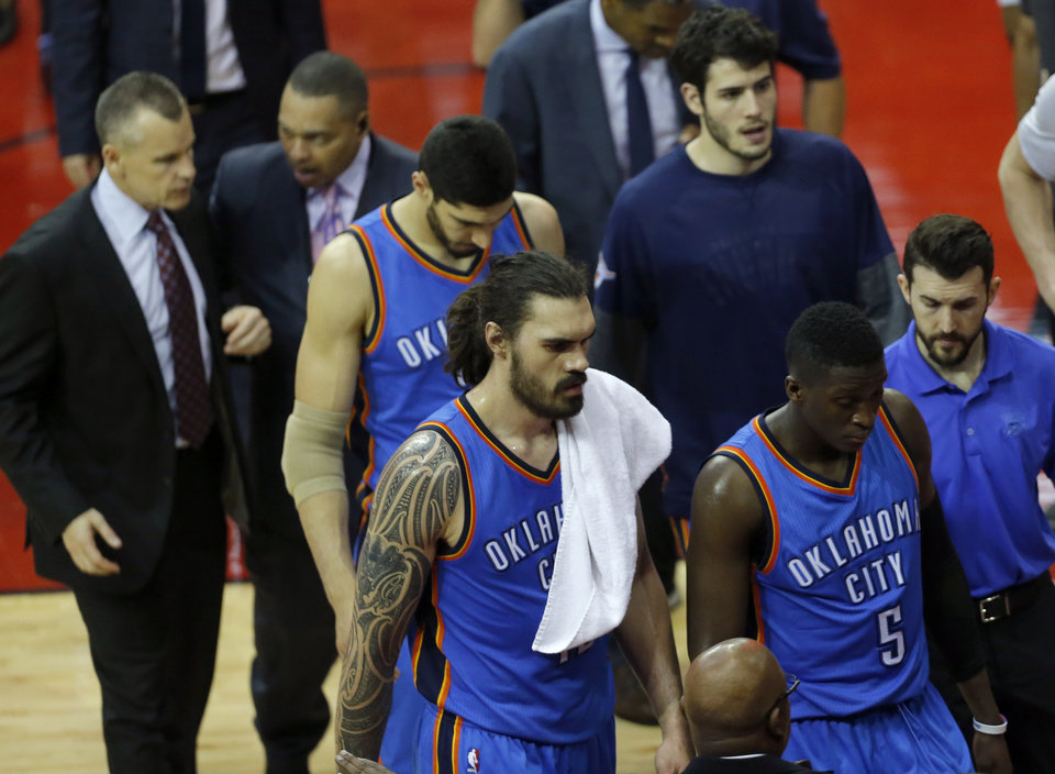 Photo - Oklahoma City's Steven Adams (12), Victor Oladipo (5), Enes Kanter (11) and Alex Abrines (8) walk off the court following Game 2 in the first round of the NBA playoffs between the Oklahoma City Thunder and the Houston Rockets in Houston, Texas,  Wednesday, April 19, 2017.  Photo by Sarah Phipps, The Oklahoman