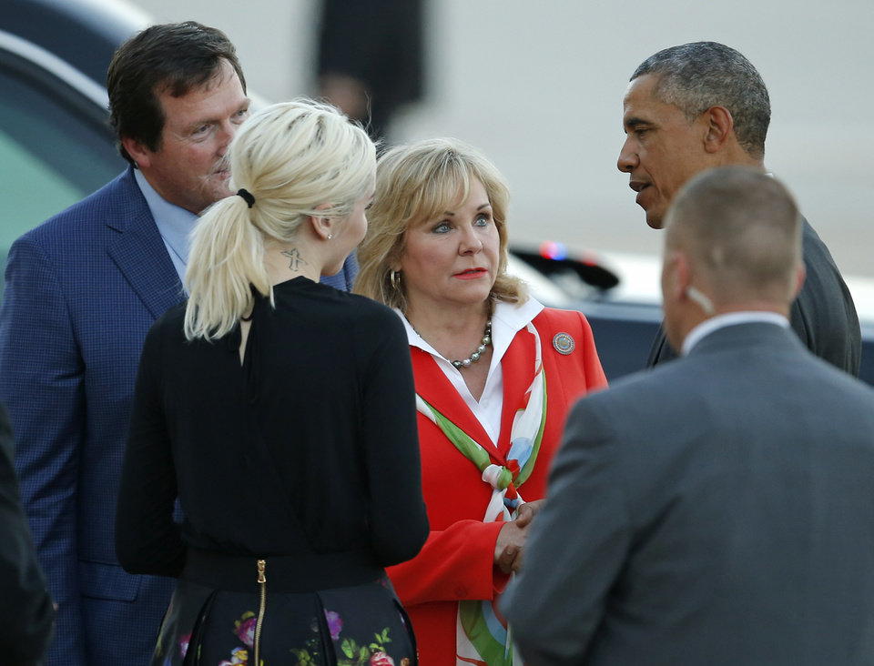 Photo - President Barack Obama talks with Gov. Mary Fallin after arriving on Air Force One at Tinker Air Force Base in Midwest City, Wednesday, July 15, 2015. President Barack Obama will visit the Federal Correctional Institution El Reno, where he will meet with Oklahoma law enforcement officials and inmates and conduct an interview for a documentary scheduled to air in the fall. Photo by Bryan Terry, The Oklahoman