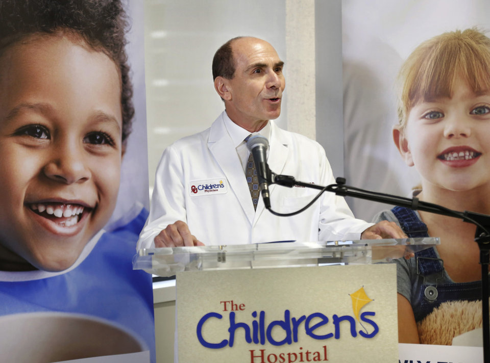 Photo -  Morris Gessouroun, M.D., chair of pediatrics, OU College of Medicine, speaks during ceremony where media were given a first look at the new facility providing state-of-the-art care for seriously ill and injured kids of Oklahoma. [Jim Beckel/The Oklahoman]