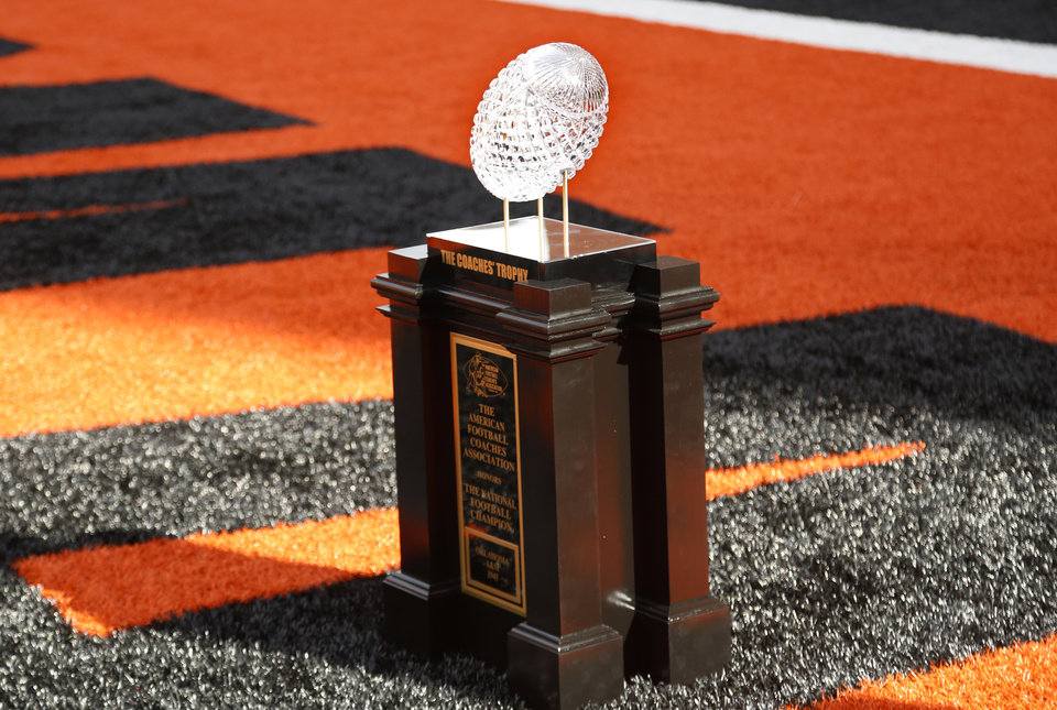 Photo - The 1945 Coaches' Trophy is pictured during a college football game between the Oklahoma State University Cowboys (OSU) and the West Virginia Mountaineers (WVU) at Boone Pickens Stadium in Stillwater, Okla., Saturday, Oct. 29, 2016. Photo by Sarah Phipps, The Oklahoman