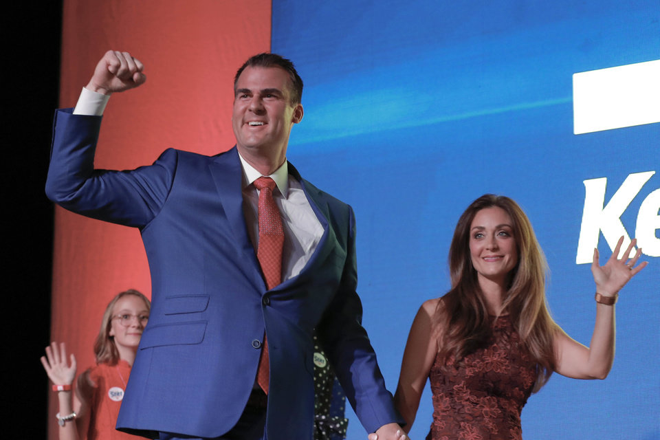 Photo - Oklahoma Republican Governor-elect, Kevin Stitt, left, and his wife, Sarah Stitt, greet supporters during a watch party in Oklahoma City, Tuesday, Nov. 6, 2018. (AP Photo/Alonzo Adams)