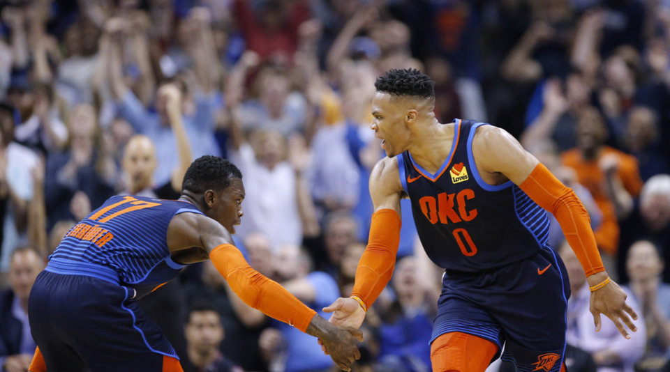 Photo - Oklahoma City's Russell Westbrook (0) celebrates his 3-point basket with Dennis Schroder (17) during the NBA basketball game between the Oklahoma City Thunder and Houston Rockets at the Chesapeake Energy Arena, Tuesday, April 9, 2019. Photo by Sarah Phipps, The Oklahoman