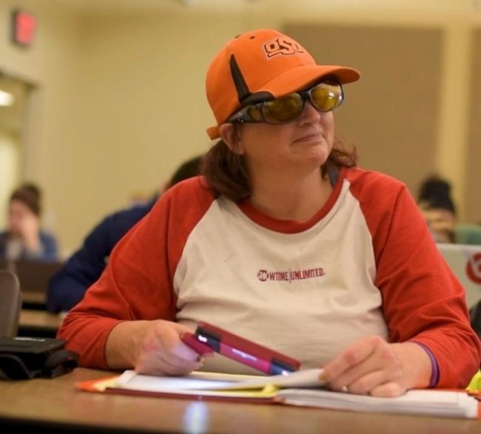 Photo -  Cathy Tuton, who has become blind because of a degenerative eye disease, is pursuing a degree in enterprise development at OSU-OKC. [Photo provided]