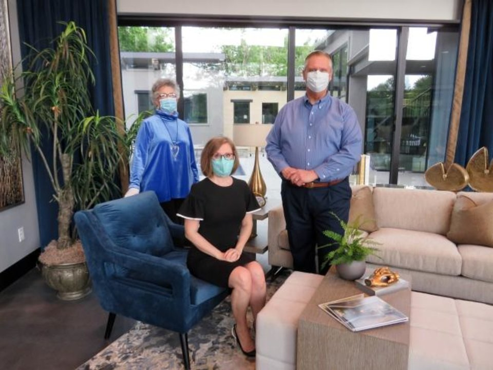 Photo -  Julia Hunt, chairman of the 2020 Symphony Show House; Lisa Reed, executive director of the Oklahoma City Orchestra League; and J. Mark Taylor, design liaison, welcome visitors to the fundraising home tour, delayed more than a month because of the coronavirus. [PHOTO PROVIDED]