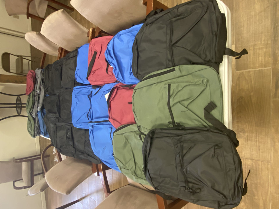 Photo - Backpacks are placed on a table at Ebenezer Baptist Church, 3600 N Kelley, where they will be given away during a drive-thru backpack distribution at 10 a.m. Saturday. [Photo provided]