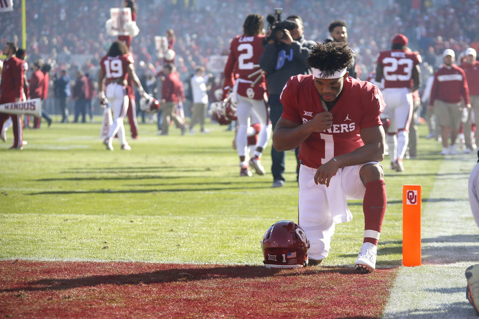 Photo - Oklahoma's Kyler Murray (1) kneels in the end zone prior to a Bedlam college football game between the University of Oklahoma Sooners (OU) and the Oklahoma State University Cowboys (OSU) at Gaylord Family-Oklahoma Memorial Stadium in Norman, Okla., Nov. 10, 2018.  Photo by Bryan Terry, The Oklahoman