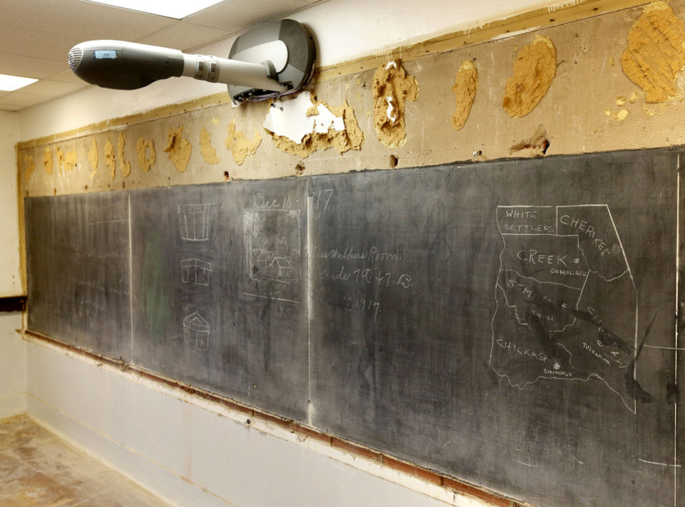 Photo - More historic blackboards covered up in 1917 have been uncovered in the 3rd floor classrooms at Emerson High School in Oklahoma City, OK, Friday, January 8, 2016. Here a modern projection device is mounted directly over the newly discovered boards, 98 years later. Photo by Paul Hellstern, The Oklahoman