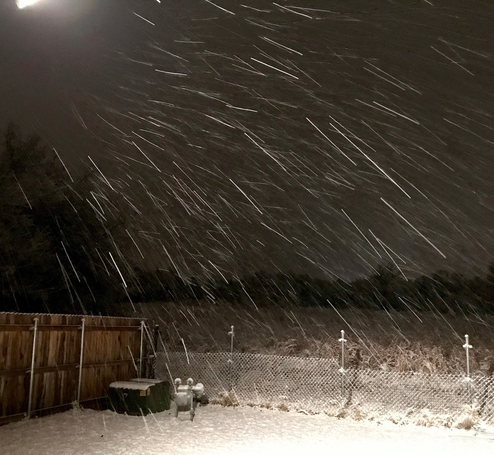 Photo - Snow in Midwest City on Thursday evening, Jan. 3, 2019. Photo by Jim Beckel, The Oklahoman