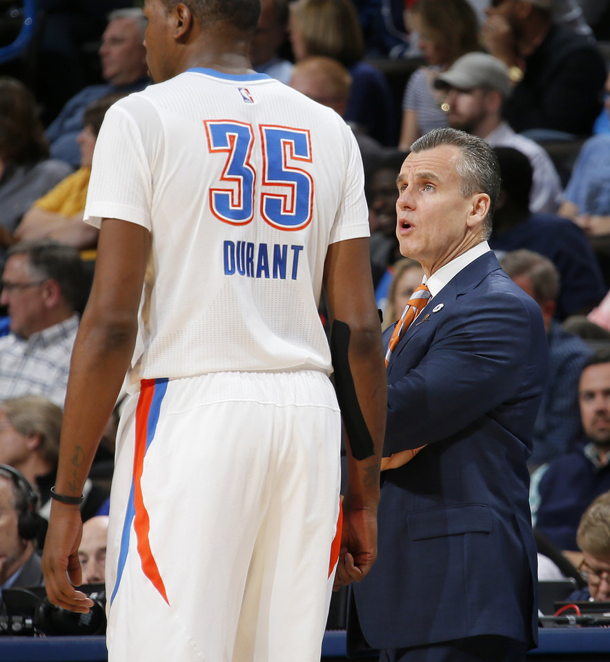 Photo - Oklahoma City coach Billy Donovan talks with Kevin Durant during an NBA basketball game between the Oklahoma City Thunder and the Houston Rockets at Chesapeake Energy Arena in Oklahoma City, Tuesday, March 22, 2016. Oklahoma City won 111-107. Photo by Bryan Terry, The Oklahoman