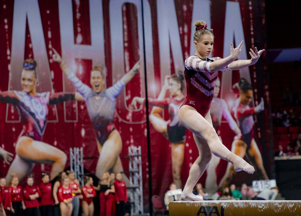 Photo - University of Oklahoma's Ragan Smith competes in the beam during the women's gymnastics competition between the University of Oklahoma and Arkansas at the Lloyd Noble Center in Norman, Okla Monday, Jan. 20, 2020.   [Chris Landsberger/The Oklahoman]