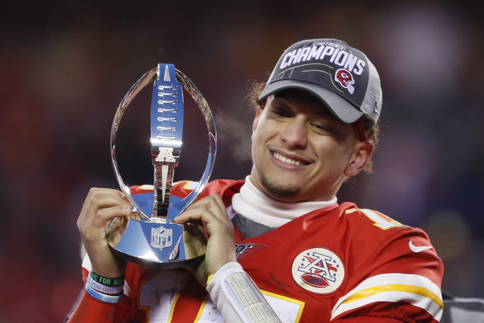 Photo - Kansas City Chiefs' Patrick Mahomes celebrates with the Lamar Hunt Trophy after the NFL AFC Championship football game against the Tennessee Titans Sunday, Jan. 19, 2020, in Kansas City, MO. The Chiefs won 35-24 to advance to Super Bowl 54. (AP Photo/Charlie Neibergall)