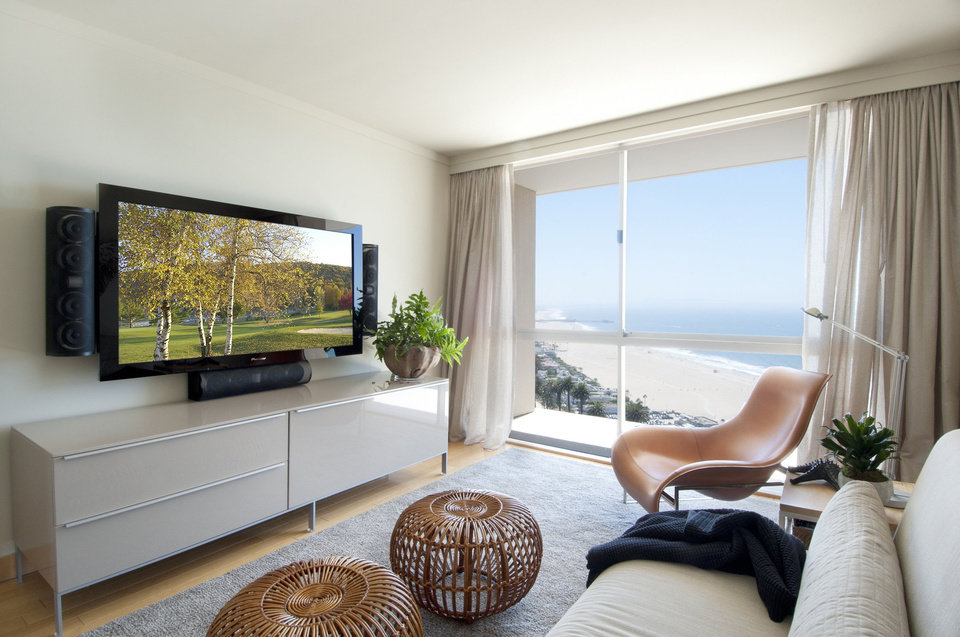 Nice By setting the TV on a credenza designer Sarah Barnard maintained the room us contemporary simplicity
