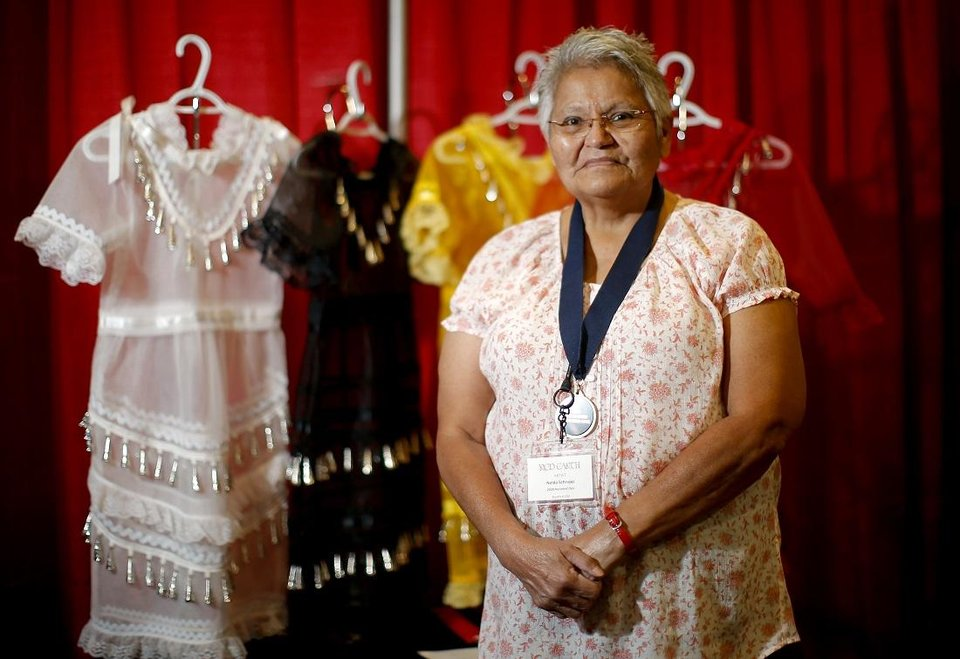 Photo - 2020 Red Earth Honored One Nelda Schrupp won first place in the cultural items category for her spirit dresses honoring missing and murdered Indigenous women and girls at the Red Earth Festival at Grand Event Center at the Grand Casino Hotel & Resort, Saturday, Sept. 5, 2020. [Bryan Terry/The Oklahoman]