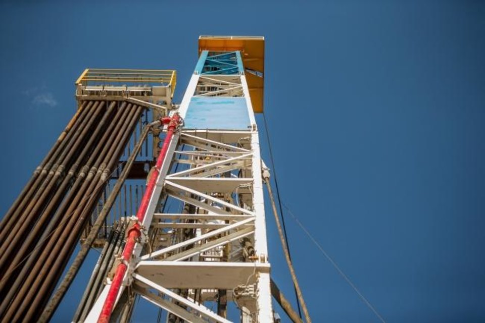 Photo -  The derrick of a rig drilling a well for WPX Energy in 2017. [PHOTO PROVIDED BY WPX ENERGY]