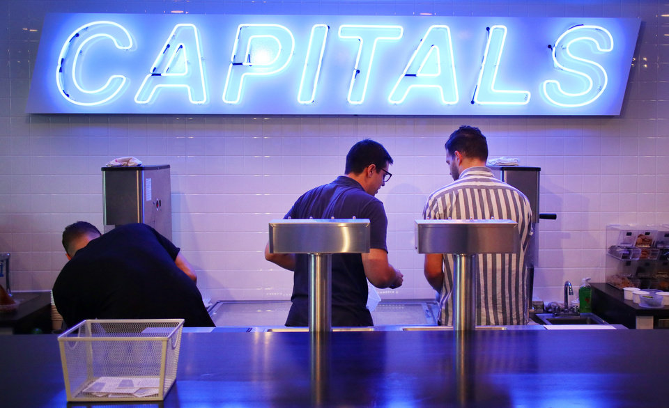 Photo - Layne Ferguson, Eric Gilbert and Landon Ferguson work on orders during the soft opening of Capitals Ice Cream at 1006 N. Hudson Avenue, Friday, May 18, 2018. Photo by Doug Hoke,The Oklahoman