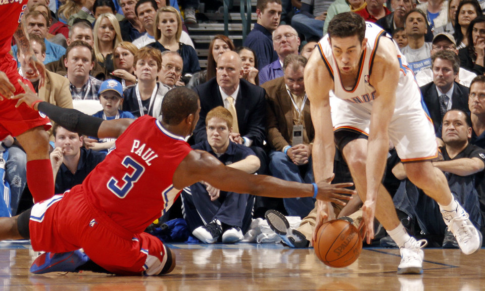 Photo - Oklahoma City Thunder power forward Nick Collison (4) gets a steal on Los Angeles Clippers point guard Chris Paul (3) during the NBA basketball game between the Oklahoma City Thunder and the Los Angeles Clippers at Chesapeake Energy Arena on Wednesday, March 21, 2012 in Oklahoma City, Okla.  Photo by Chris Landsberger, The Oklahoman