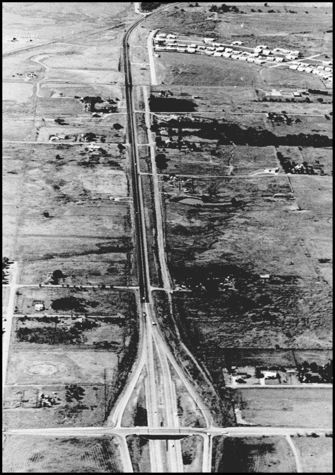 Photo - HIGHWAYS / CITY / BROADWAY EXTENSION: UNKNOWN: Caption reads, Destined for four-laning and conversion to expressway is this 2-lane stretch of Broadway Extension north of Britton Rd. Staff Photo by Jim Lucas. Original Photo 08/20/1965. Published on t-9-6-65.