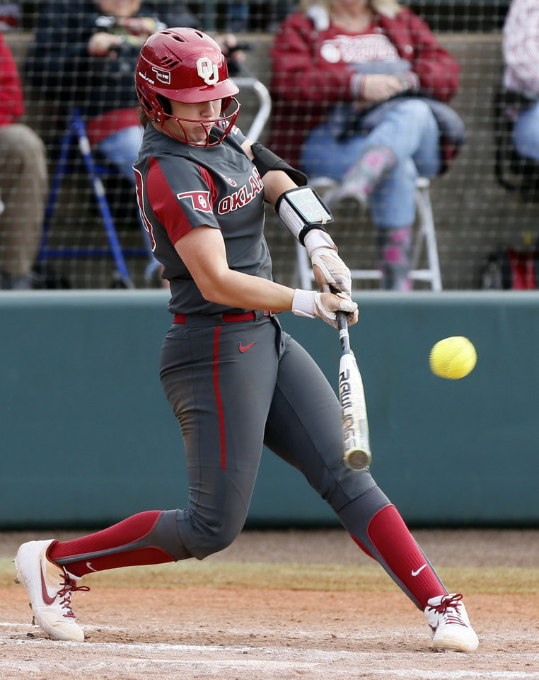Photo - OU's Caleigh Clifton (20) hits a two-run home run in the seventh inning during a college softball game between Oklahoma and Wisconsin in the NCAA Norman Regional at Marita Hynes Field in Norman, Okla., Saturday, May 18, 2019. OU won 4-0. [Nate Billings/The Oklahoman]