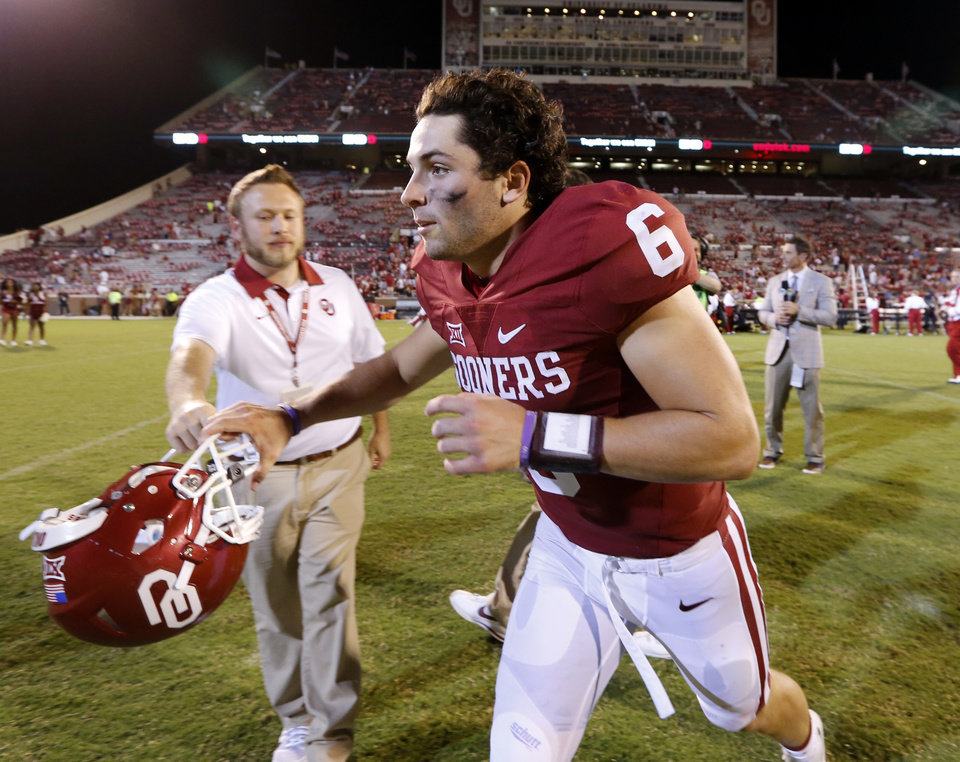 Photo - Oklahoma's Baker Mayfield  leaves the field following the college football game between the University of Oklahoma Sooners (OU) and the Akron Zips at Gaylord Family-Oklahoma Memorial Stadium in Norman, Okla., on Saturday, Sept. 5, 2015. Photo by Steve Sisney, The Oklahoman