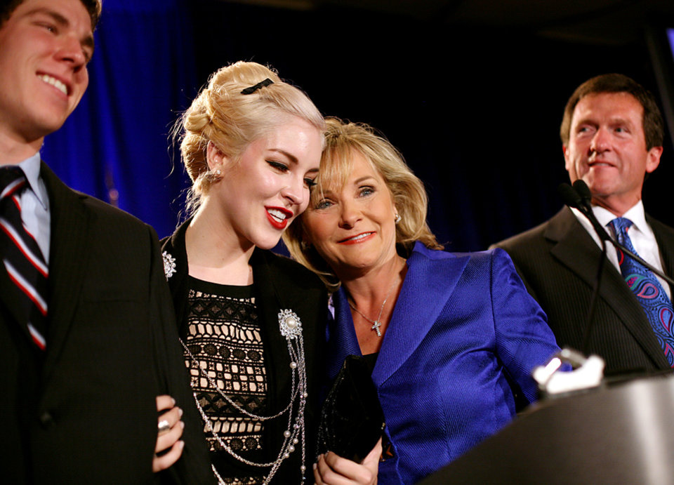 Photo - Governor Elect Mary Fallin shares a moment with her daughter Christina (center) her husband Wade Christiansen (right) and her son Price Fallin, during the Republican Watch Party at the Marriott in Oklahoma City on Tuesday, Nov. 2, 2010.Photo by John Clanton, The Oklahoman