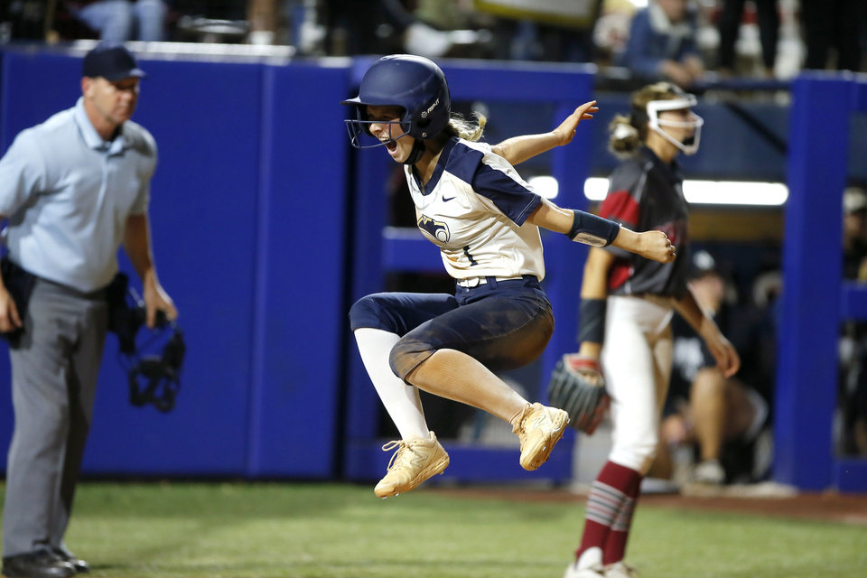Photo - Southmoore's Abi Jones celebrates after scoring the game-winning run during the Class 6A state softball championship game between Southmoore and Owasso at USA Softball Hall of Fame Stadium in Oklahoma City, Saturday, Oct. 17, 2020. [Bryan Terry/The Oklahoman]