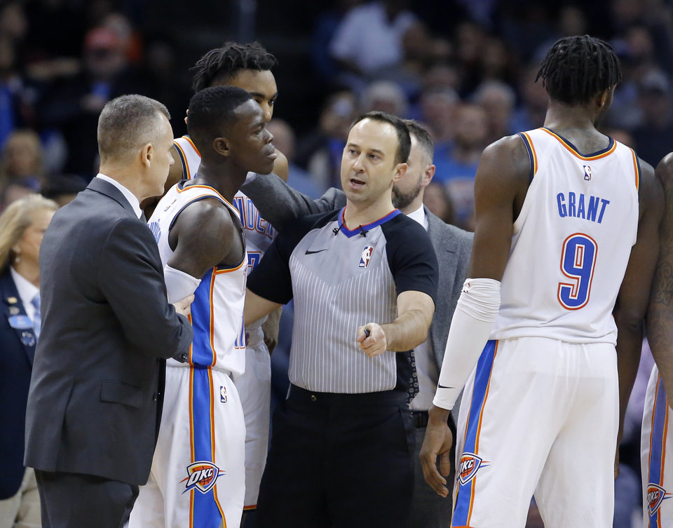 Photo - Oklahoma City head coach Billy Donovan holds back Oklahoma City's Dennis Schroder (17) after he is called for a technical foul during the NBA game between the Oklahoma City Thunder and Minnesota Timberwolves at the Chesapeake Energy Arena, Tuesday, Jan. 8, 2019. Photo by Sarah Phipps, The Oklahoman