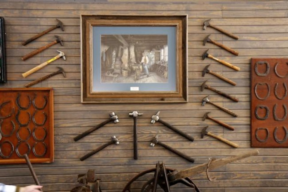 Photo -  Horseshoeing tools displayed at the opening of the Museum of Horseshoeing in south Oklahoma City. [Doug Hoke/The Oklahoman]