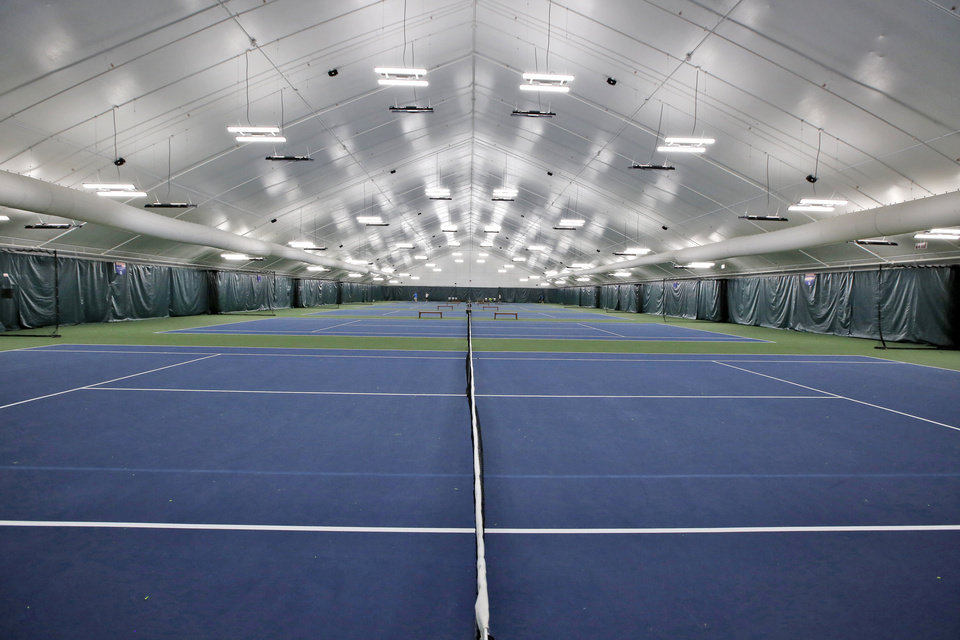 Photo -  The new indoor courts at the Oklahoma City Tennis Center at Will Rogers Park in Oklahoma City, Wednesday February 17, 2016. Photo By Steve Gooch, The Oklahoman